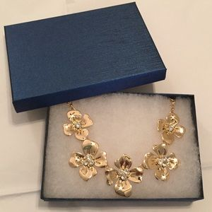 Gold tone floral necklace in gift box. NWT